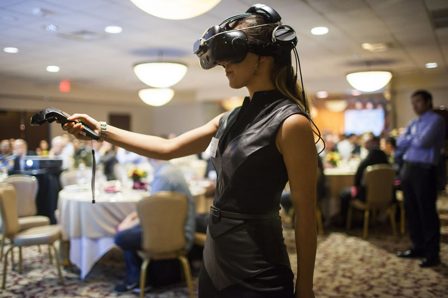 virtual-reality-woman-with-vr-goggles-at-conference