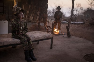 Black Mambas Women Anti-poaching Unit - women-in-camp-in-the-evening-with-open-fire