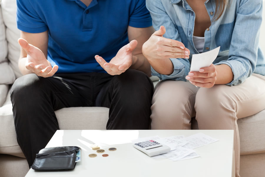 Dating Money - couple-with-money-sitting-on-couch