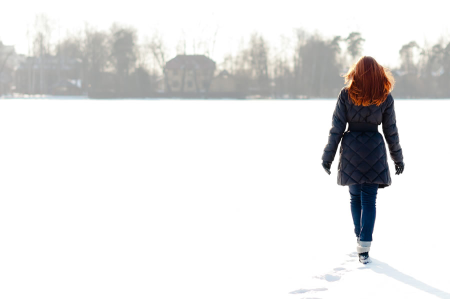 Seasonal Affective Disorder - SAD - woman-with-red-hair-walking-on-snow