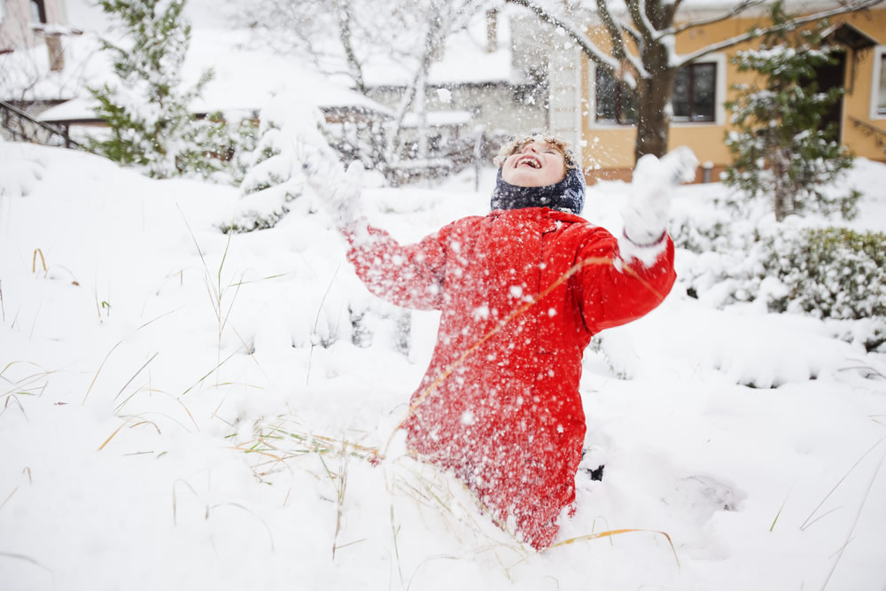 Holiday Spending - child in snow