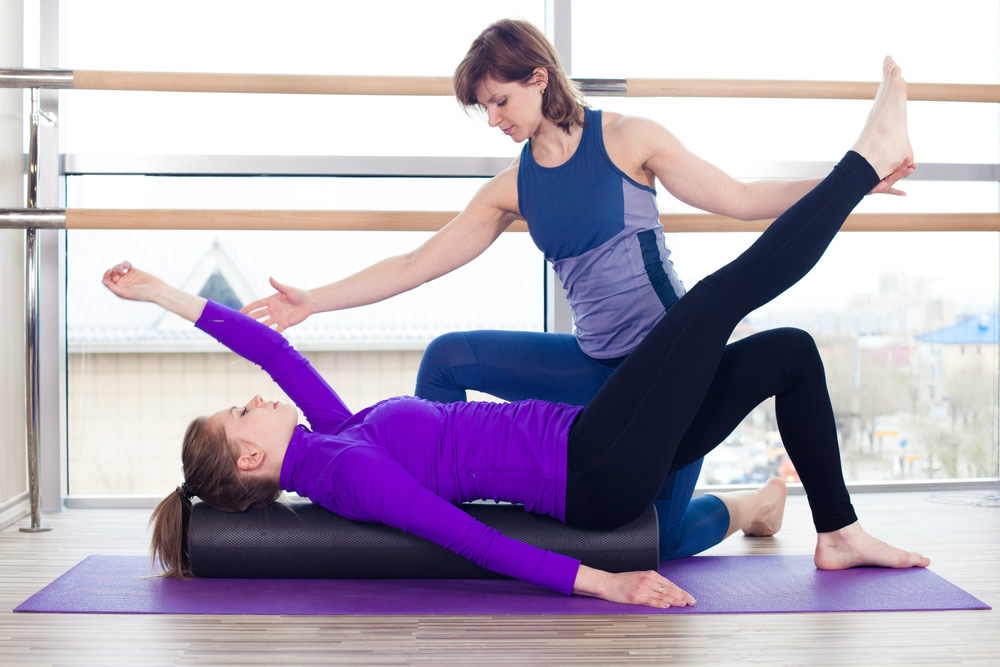 woman with purple jacket and personal trainer