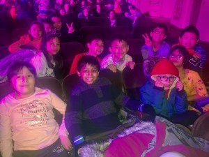 another group of third grade students sitting in the audience
