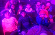 Another photo of the third grade students sitting in the audience