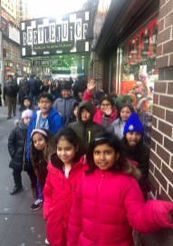 Third grade students pose outside of the entrance to Beetlejuice on Broadway