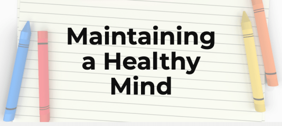 An image of paper and crayons around the words maintaining a healthy mind