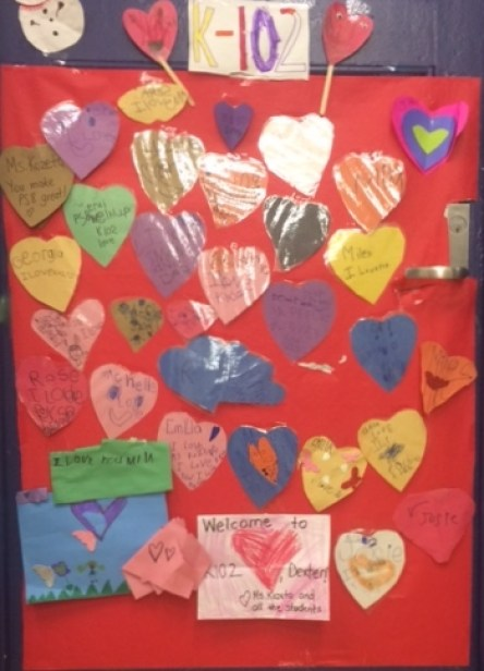 Kindergarten classroom door decorated with multicolor hearts the students deocarated with their names