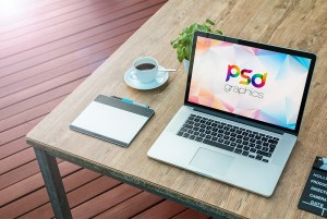 Macbook Pro on Table Mockup Free PSD