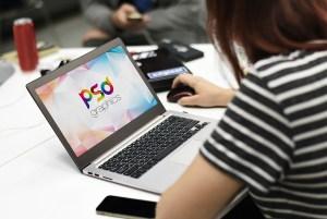 Female Working on Macbook Mockup PSD
