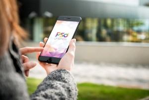 Women Holding iPhone Mockup PSD