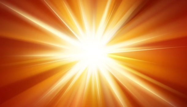 Orange light burst background