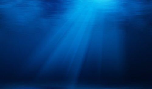 Blue underwater with sun rays background
