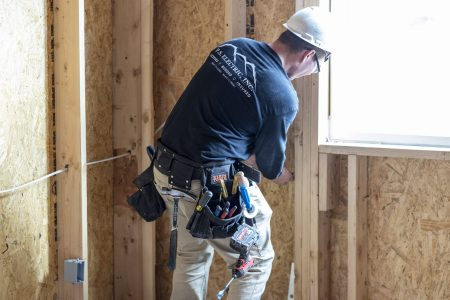 P.S. Electric, Inc. - New Construction - Male Electrician Working