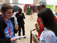 Jake Lutes, left, interviewing some fans at the Open.