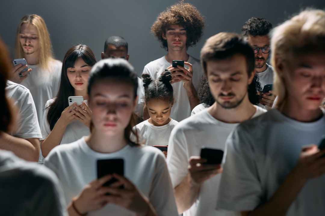 photo of people engaged on their phones