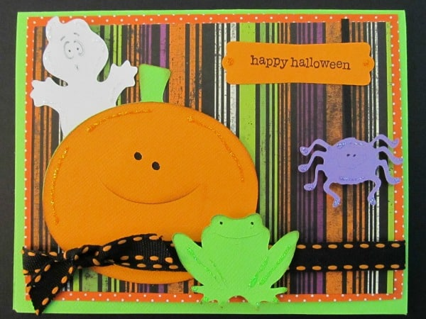 These handmade Halloween Cards, Invitations, and Treat Bags use a variety of materials from buttons to the Cricut. With just a few supplies, you can create fun Halloween paper crafting projects too. This Cricut Ghost card has great Halloween Cricut shapes including a frog, jack-o-lantern, ghost, and spider.