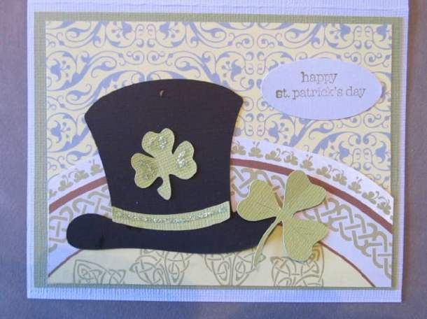 Leprechaun Hat and shamrocks - St. Patrick's Day Cards are easy to make with an assortment of green and white papers, shamrock die cuts, pot of gold stickers, buttons, rhinestones, glitter, and foam shapes.
