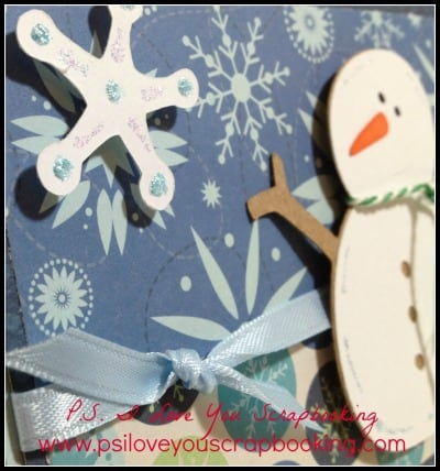 This snowman card is made using the Doodlecharms Cricut Cartridge, patterned paper, baker's twine, markers, ribbon, and a little glitter.  Post includes a video showing step by step how to cut and assemble the pieces.
