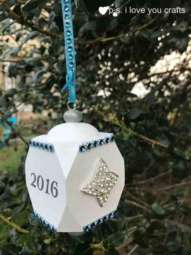 Our First Christmas Together Ornament - Using a wooden ornament, paint, rhinestones, Wink of Stella, and the Cricut Explore, I made a beautiful Christmas ornament for my daughter and son-in-law's first Christmas together. I used rhinestone brooches that were in my daughter's bridal bouquet to make this keepsake that they will cherish forever.
