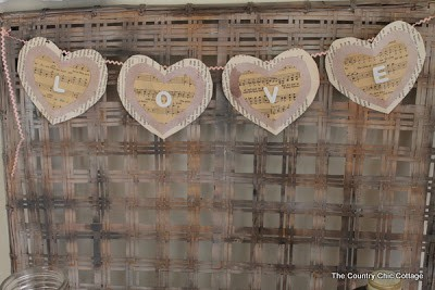 Love Bunting Banner for Valentine's Day - DIY Pennant Banners can be made for any holiday or occasion. They look great hanging on a mantel as part of your home decor or on the wall for a party decoration. They are easy to make to fit any theme or budget. They are particular popular for birthday parties, and bridal showers,