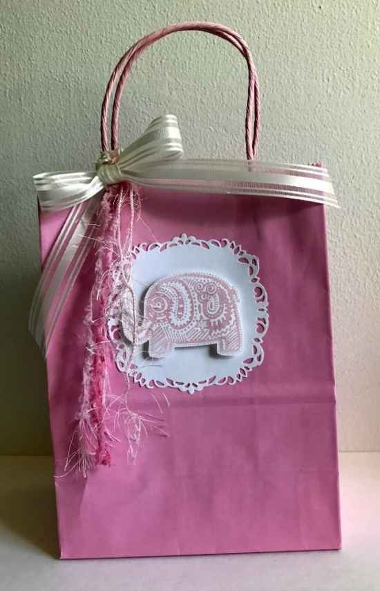 Make a Baby Shower Gift Bag Using scrapbooking paper, rubber stamps, and other card making supplies.
