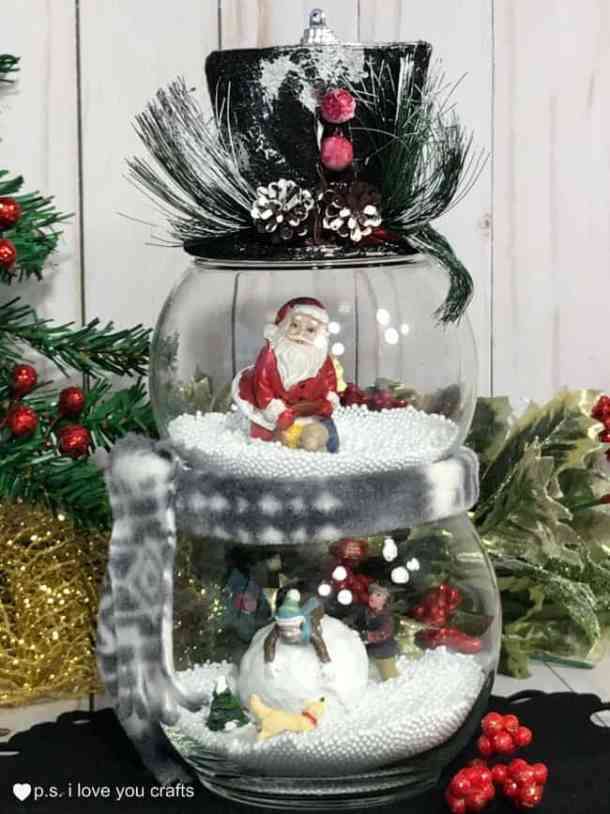 Make a Dollar Store snow globe Christmas decoration in 10 minutes!  It's a quick, easy, inexpensive Christmas Craft.