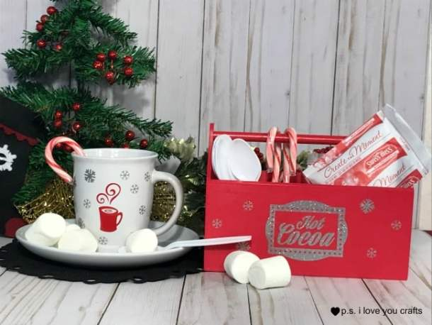 Make a Hot Chocolate Caddie using a wooden caddie, and adhesive silver glitter vinyl. You can cut the designs with the Cricut Maker or Cricut Explore Machine. I added a cute hot cocoa mug to make a cute set. #hotchocolate #hotcocoa #cricut #cricutmaker