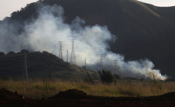 A bushfire is burning in a deforested part of the Atlantic Forest.
