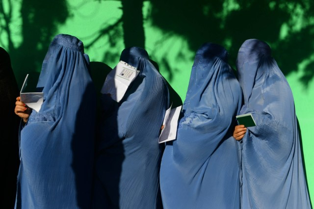 Afghan women wait in line to vote at a polling center in Herat Province on October 20th, 2018.