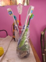 A tooth brush holder we made out of a plastic bottle.