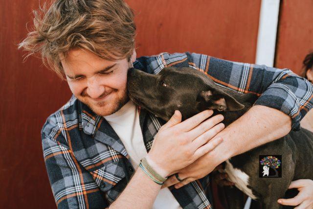 man-pet-dog-smile-hug