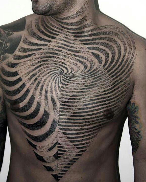 Hypnotizing chest tattoo by Narazeno Tubaro