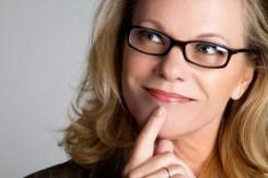 Thinking woman wearing glasses