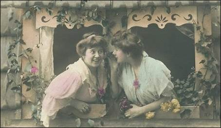 Old postcard showing two women excitedly talking to each other.