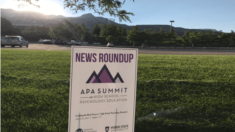 Mountains with yard sign for APA high school psychology summit