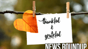 white card on clothes line with heart shaped leaf. Text, thankful & grateful and News Roundup