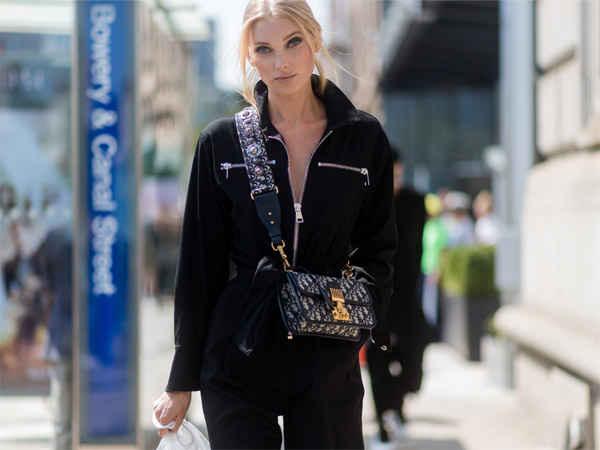 model with cross-body bag