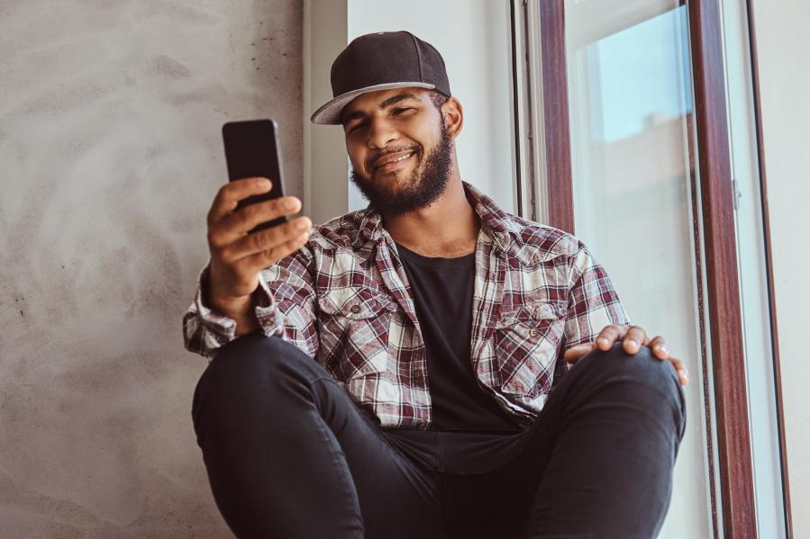 african american bearded guy chatting in the social network
