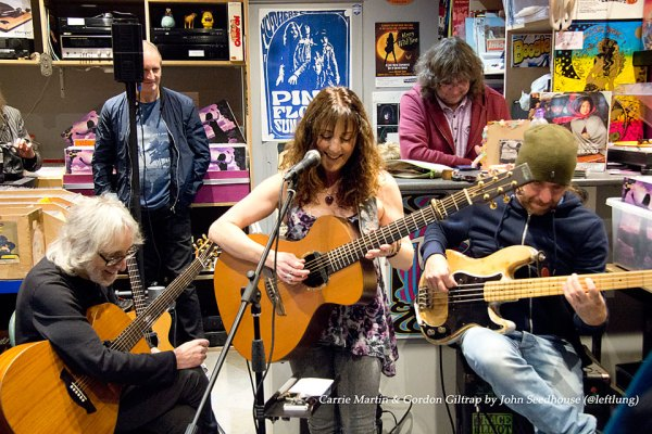 Gordon Giltrap Carrie Martin and Jamie Fowler performing in the Psychotron Records shop
