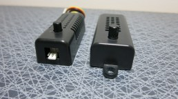 Zalman Fan Mate 2 (right, USD 7) and eBay ditto (left, USD 2.3). The male connector on the eBay regulator visible to the left