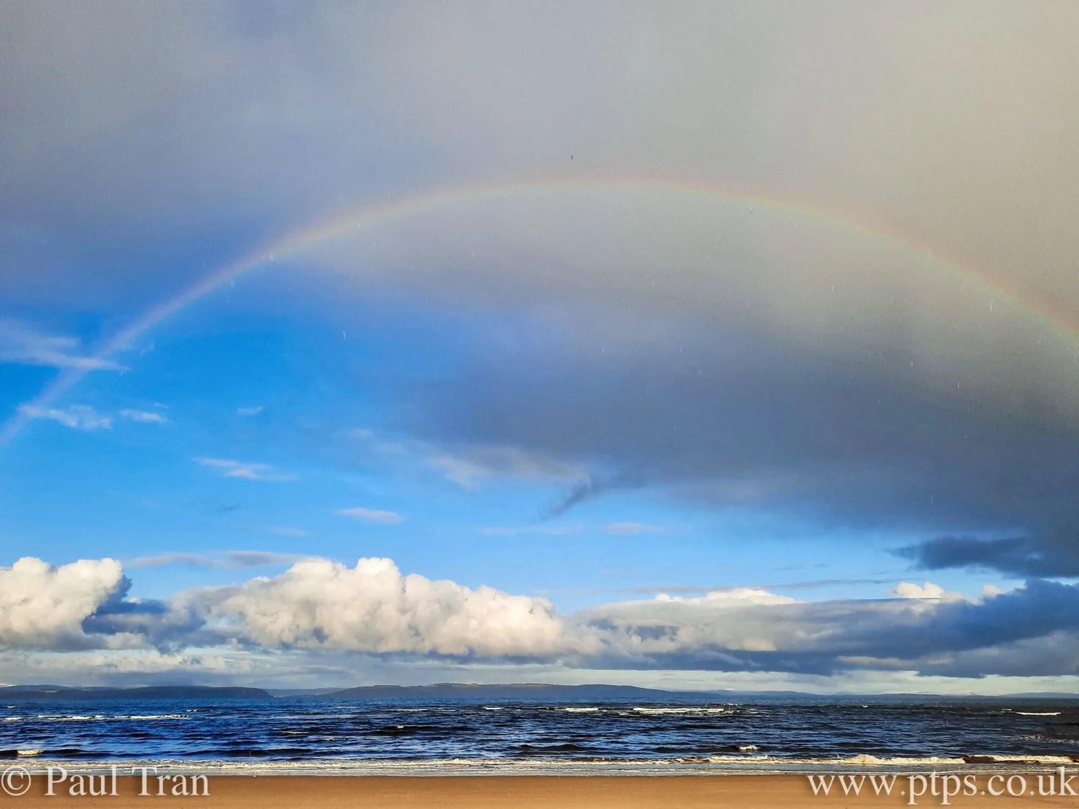 rainbow across the water