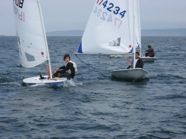 Cody luffs before the start of a competitive Laser race ...
