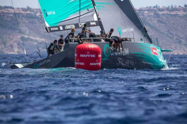 Photo by  Keith Brash/Quantum Racing      The telltales of a clean leeward mark rounding: a good upwind exit angle, crew on the rail, no ghosts on the foredeck.