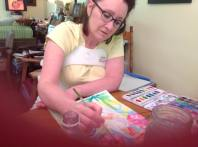 Sitting up in body cast, watercolor painting, not allowed to lift elbows off of the table.