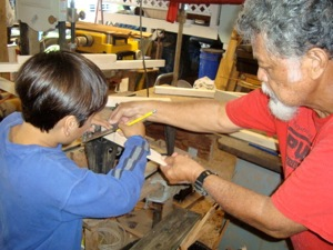 Uncle Bobby teaching a young boy woodworking skills