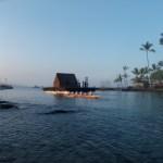 Makapo crew paddling out of the harbor at sunrise