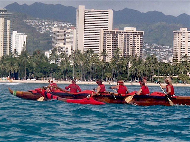 Women's crew approaching the finish line of the Na Wahine o ke kai race