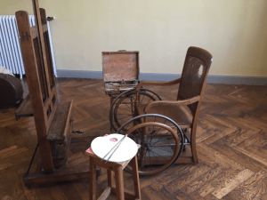 Renoir's wheelchair, easel, palette, and paint box; Musée Renoir in Cagnes-sur- Mer