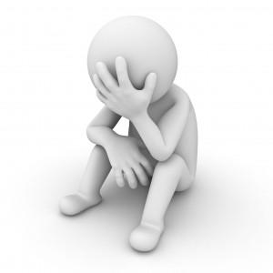 12432428 - stress 3d man sitting on white background