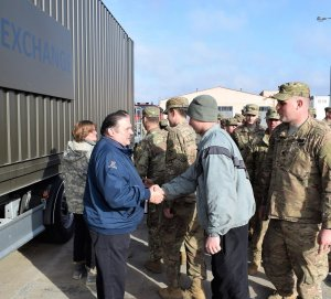 Ron McCool and the Exchange team receive a unit's gratitude for a job well done. On the Exchange mission's last day, Soldiers line up to thank the Exchange associates for their service at Poland's Drawsko Pomorskie Training Area.